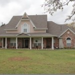 Two-story residential home roofing project in OK