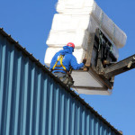 Loading materials onto a roof for a new commercial project
