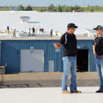 Two Coryell roofers discussing a commercial project