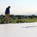 Two Coryell roofers inspecting a commercial roof