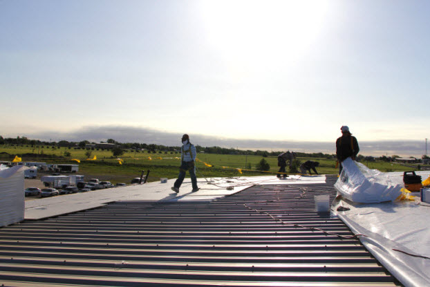 Group of Coryell roofers working on commercial roofing project