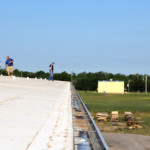 Roofing gutter with Coryell specialist in the background