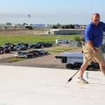 Coryell inspector walking on newly completed roof