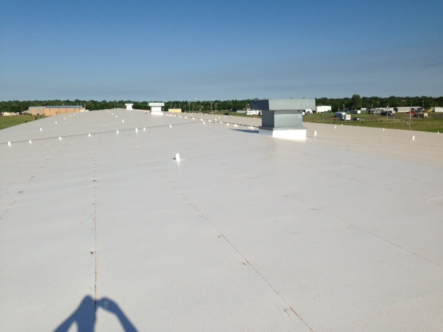 Coryell employee taking image of completed roofing project