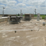 Before image of commercial roofing system project by Coryell
