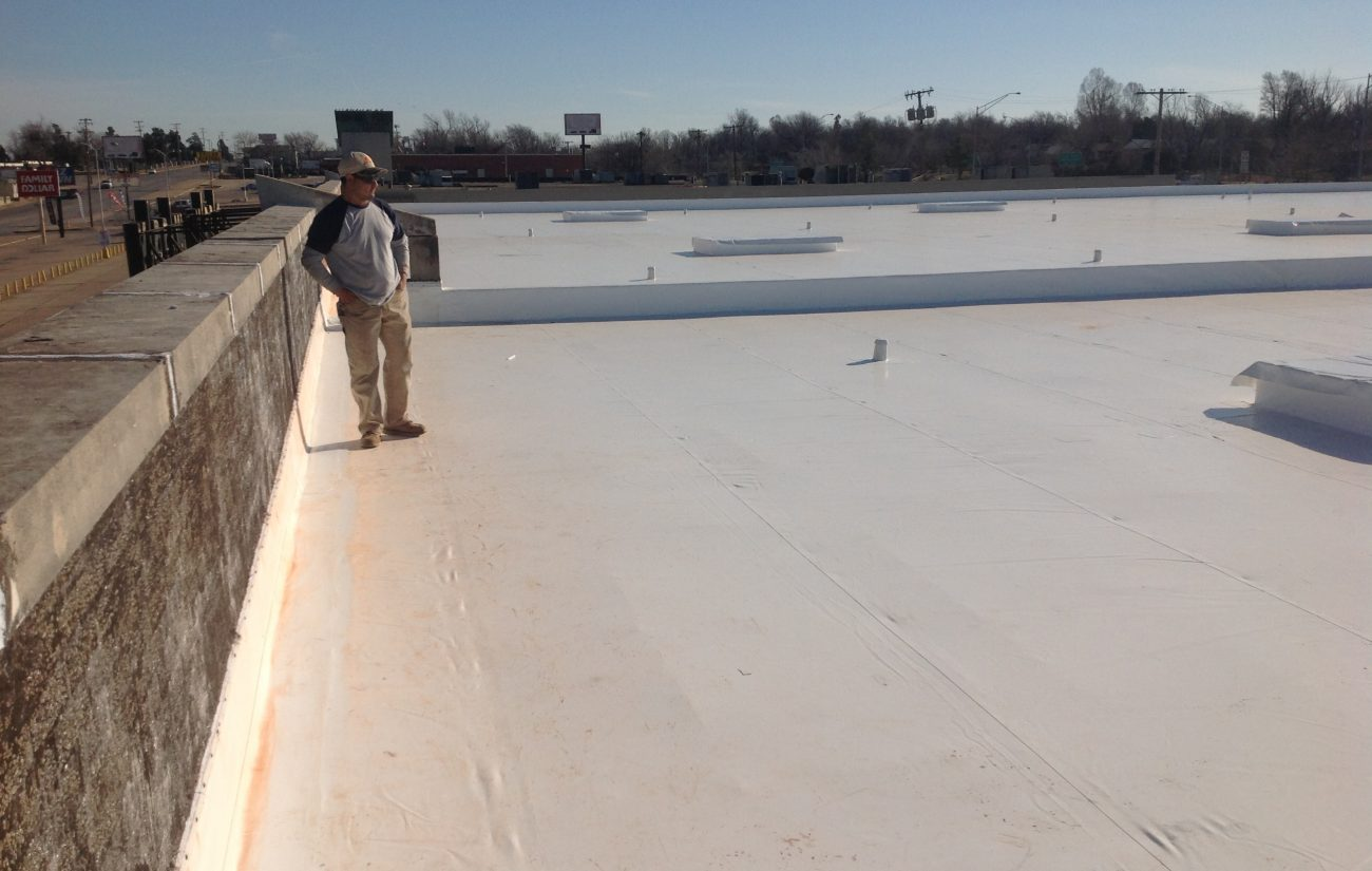 Coryell Roofer On Finished Commercial Roof