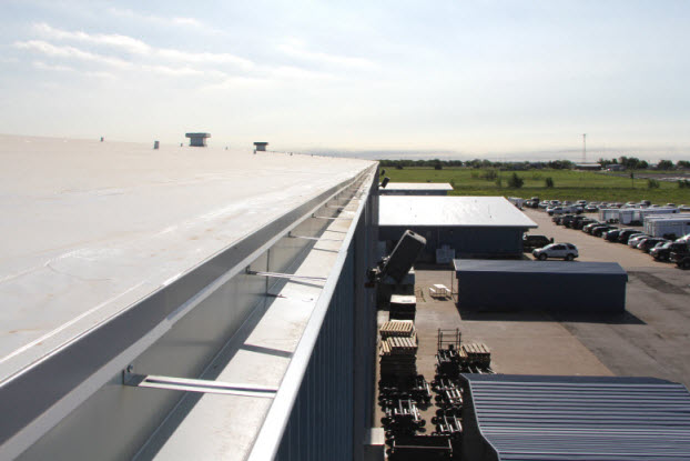 Image of right gutter on new roofing system in Oklahoma