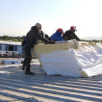 Three Coryell roofers installing a Duro-Last roofing system