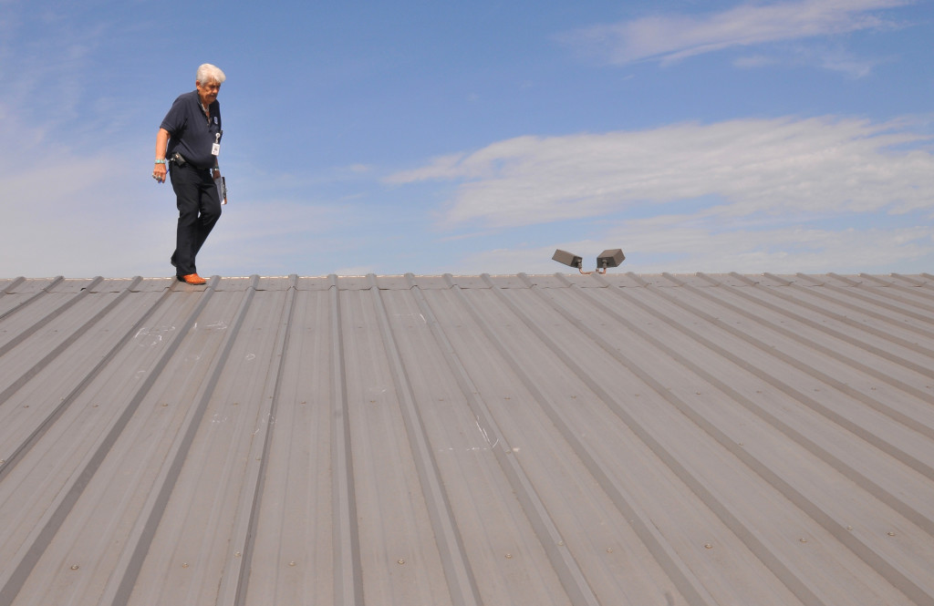FEMA inspector on a roof in Oklahoma