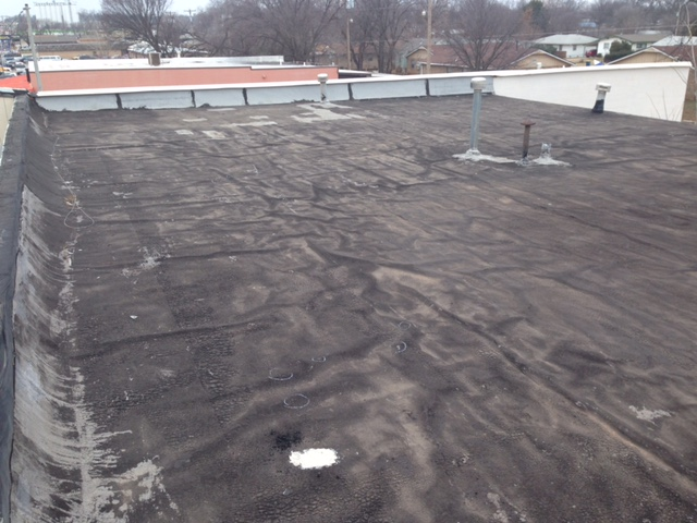 Commercial Roofing System Replacement in Stillwater, OK - Before Image
