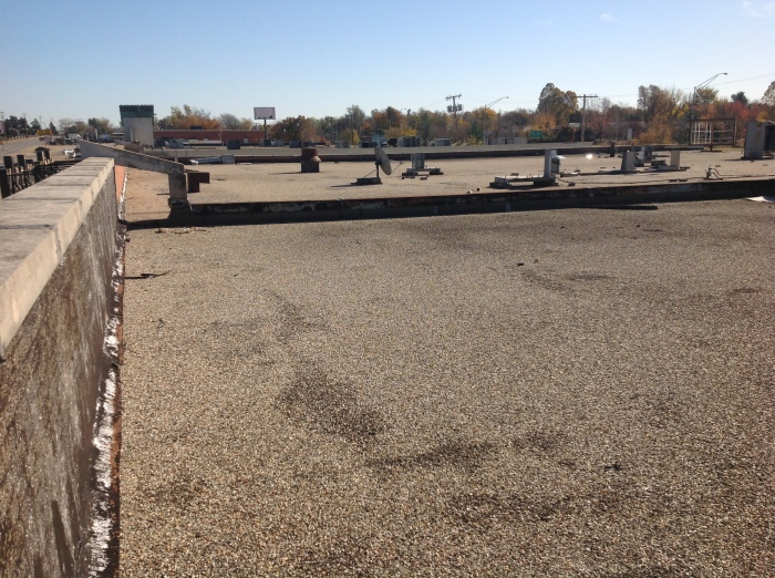 Durolast Metal Retrofit Roof System in Tulsa, OK - Before Image